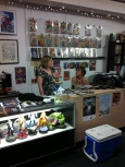 Rachel and Debbie behind the new showcase and counter set-up the night before FCBD.